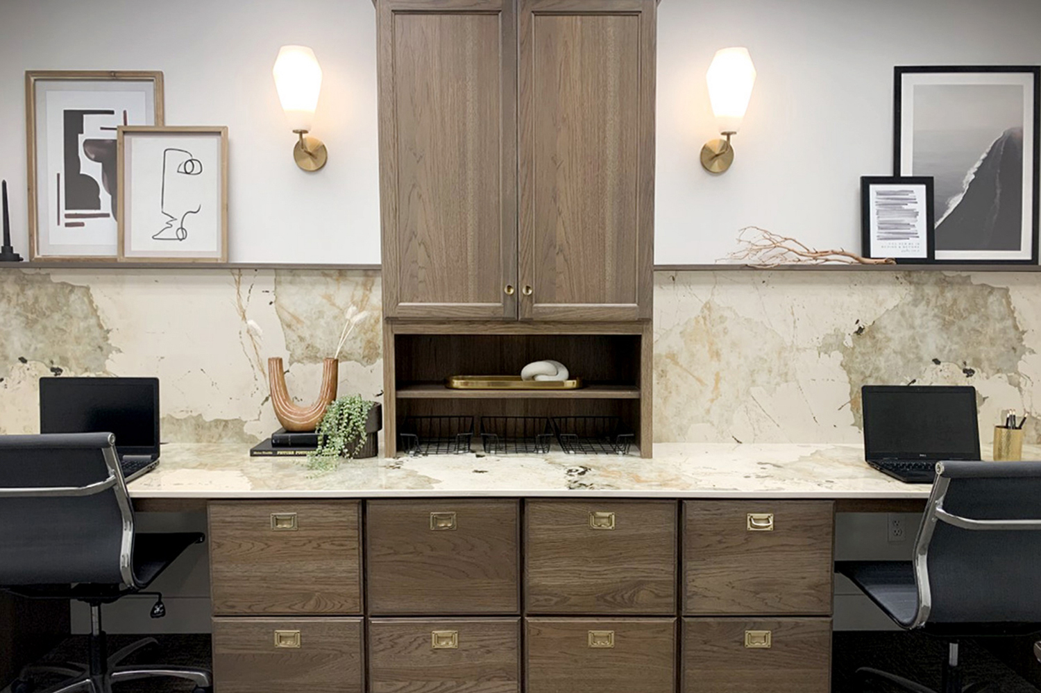 Image of office with built-in cabinets and marble countertop